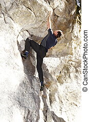 bouldering man - man is bouldering on a rock wall