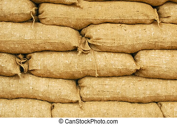 sandbags - background of sandbags for flood defense or...