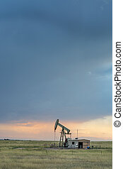 oil rig on a Colorado prairie - oil rug (pumpjack) against...