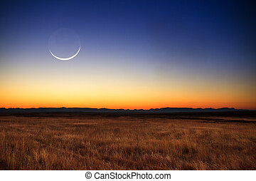 Moon landscape - Beautiful new moon at sunset in Madagascar