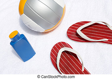 Volley ball, flip flops and sunscreen - A summer composition