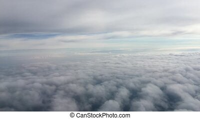flight airplane above  clouds