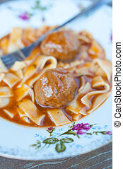 meatballs with nudle - meatballs with meat sauce on the old...