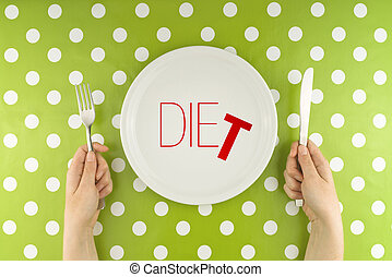 Hands hold flatware above dieting plate - Female hands at...