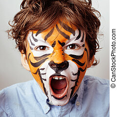 little cute boy with faceart on birthday party close up,...