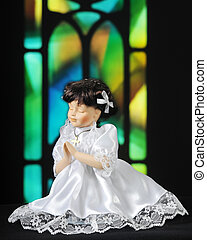 Prayerful Doll - A praying doll dressed for communion,...