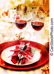 Holiday Dinner Table Setting - Red and gold themed holiday...