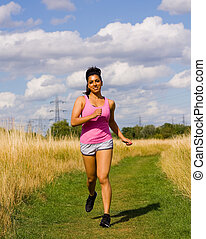 Young woman exercising outdoors.