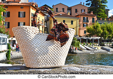 Basket against varenna town, lake Como, Italy