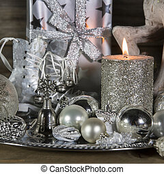 Festive christmas decoration in silver with burning candles....