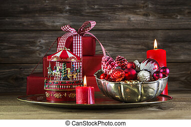 Red christmas decoration on wooden background with carousel...