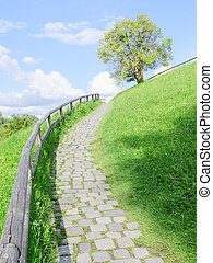 Long and difficult upstairs road, paved with cobble stones,...