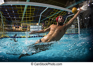 A water polo goalkeeper and the ball going into the net of...