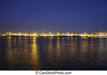 Hamburg Harbor Skyline - Brightly lit harbor facilities at...