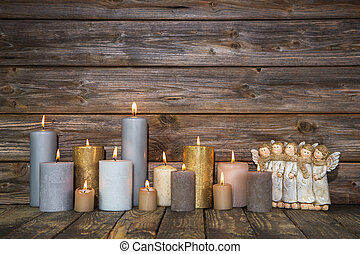 Christmas greeting card with candles and angels on wooden...