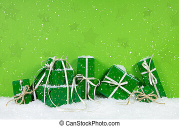 Green christmas gift boxes on white snowy background. -...