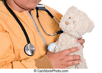 Stuffed Animal Care - Closeup of a young girl holding a...