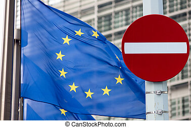 No entry sign in front of EU flag