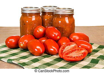 Jars of tomato sauce with paste tomatoes - Jars of fresh...