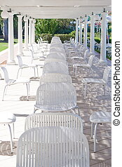 Chairs under a patio