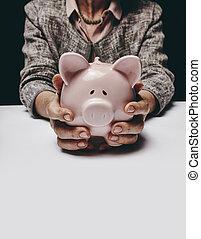 Saving for her retirement - Cropped studio shot of senior...