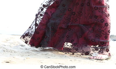 burgundy dress developing in the wind