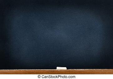 Blackboard with Chalk and Dust - A blackboard (chalkboard)...