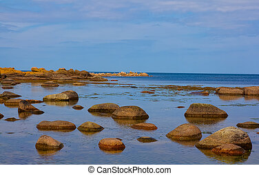 Stepping stones in water - Stepping stones at the shore of...