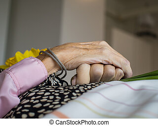 The last journey - A dead womans peacefull crossed hands
