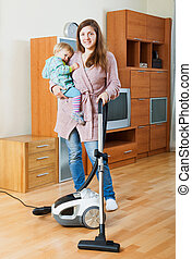 Woman  cleaning living room with vacuum cleaner
