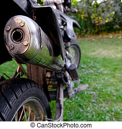 Motorcycle exhaust closeup - Looking in to a muffler of an...