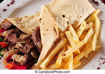 Shawarma - Stuffed pita bread with french fries
