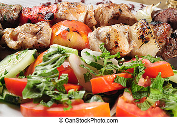 Salad and shish kebab - Grilled meat and chicken with salad