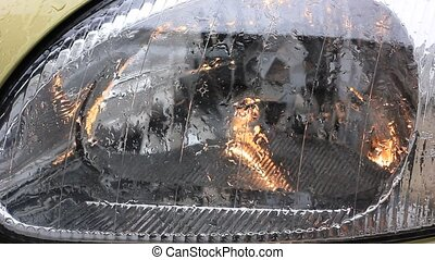 headlight of car under the rain