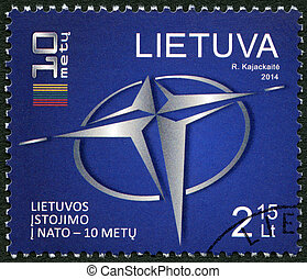 LITHUANIA - 2014: showis logo of NATO and a stylized flag of...