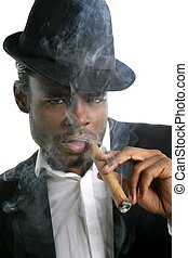 African american man smoking cigar portrait with black hat