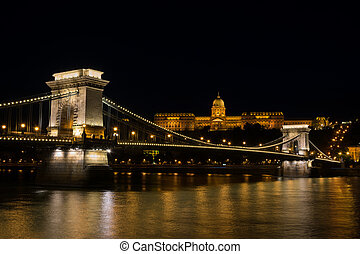 Chain bridge Budapest Hungary illuminated at night with old...
