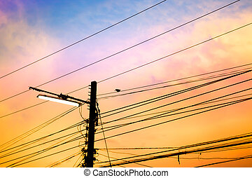 electricity poles at sunset with colorful cloud