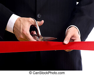 Cutting Red Ribbon - A business man wearing a blue suit...