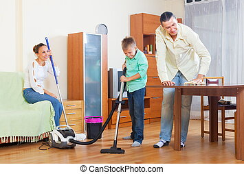 Couple and boy dusting together - Ordinary couple and...