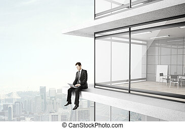 businessman with laptop - businessman sitting on skyscrapper...