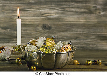 First advent: christmas decoration in gold and silver with a...