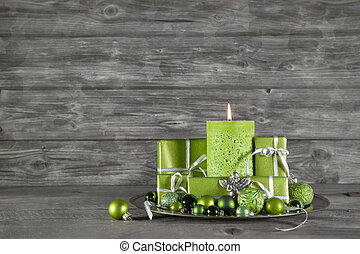 Wooden christmas or advent background with green decoration,...