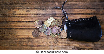 purse with old coins in long background - purse with old...