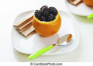 orange and blackberry - This dessert was made by placing an...