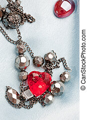 bijouterie - object series: accessories, beads and red heart