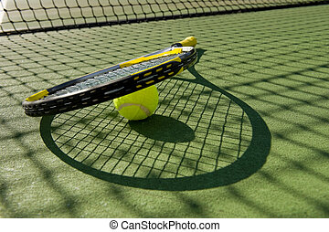 Tennis Racket and Ball on Court - A tennis racket and new...
