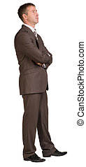 Businessman stands in half-turn. Isolated on the white...