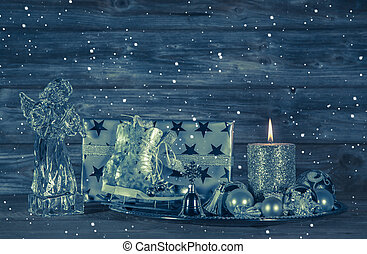 Dark blue christmas decoration with candle and presents on...