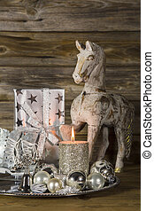 Natural christmas decoration in silver and brown on wooden...